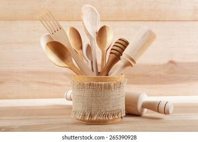 Set of kitchen utensils on wooden board.