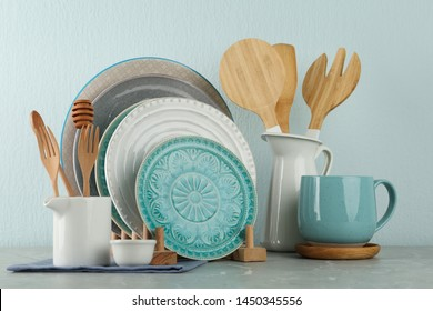 Set of kitchenware on grey marble table near light wall. Modern interior design