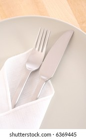 set of knife fork and plate on the table