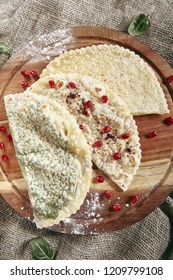 Set of Kutabs on Rustic Tablecloth Burlap Background. Qutab, Kutab or Gozleme is Thinly Rolled Dough with Cheese and Greens that is Cooked Briefly on a Convex Griddle Top View