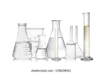 Set of laboratory glassware filled by colorless isolated on white background.