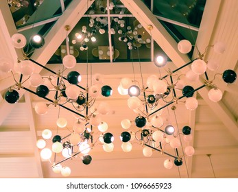 Set of lamps under a roof in abstract composition.