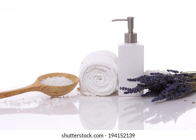 Set of lavender with massage oil and white towel, salt in spoon