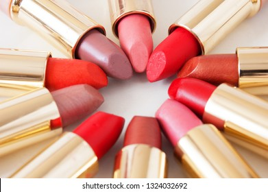 Set of lipstick on white background. Red, pink, wine, vinous, beige,nude . Colorful Tones,Lipstick tints palette, Professional Makeup and Beauty.