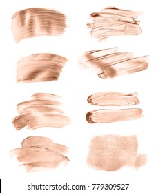 Set of liquid foundation strokes isolated on white background