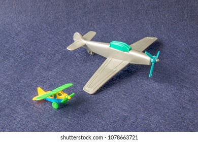 Set of little vintage airplanes in miniature. Macro photograph of midget aircrafts. Isolated on dark background