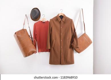 Set of long brown coat with sweater, on hanging handbag, hat