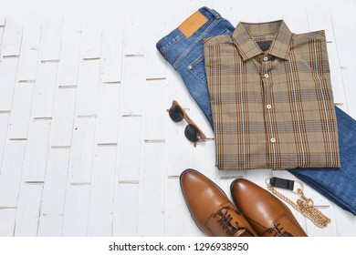 set of long shirts ,blue jeans and leather shoes,sunglasses, purse