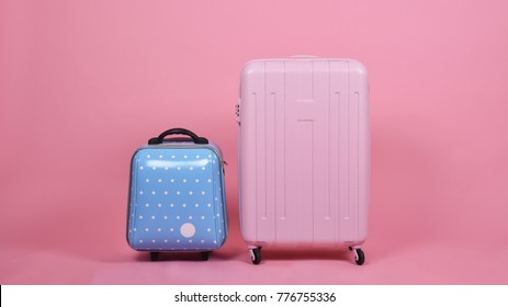 Set of luggage suitcase, Traveler pink suitcase and blue cabin size luggage on pink background, Journey and travel concept.