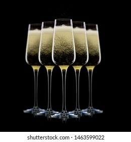 Set of luxury champagne glasses in a row on a black background. IConcept of winemaking and restaurant business