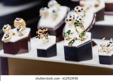 Set of luxury jewelry with precious gems and stones on a showcase of a shop