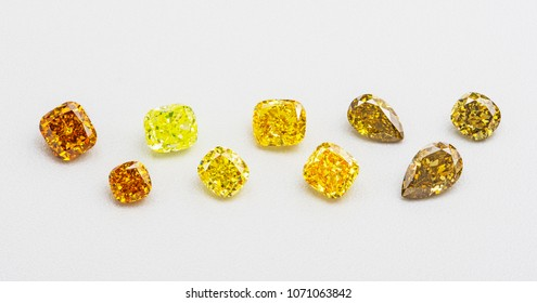Set of luxury yellow and brown transparent sparkling gemstones of various cut shape diamonds collage on white background.