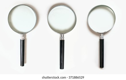 Set of magnifying glasses with shadow isolated on white background. High resolution.