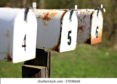 A set of mailboxes with the numbers four, five, and six on them