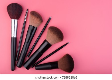 Set of make up products arranged on pink background