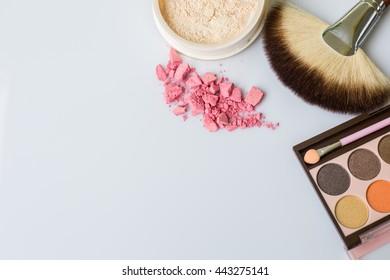 Set make-up brushes, eye shadows,loose powder  on white background.