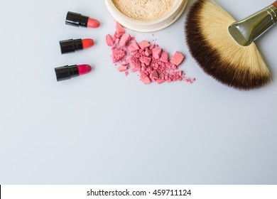 Set make-up brushes, eye shadows,loose powder on white background.Pink and Red lipstick.