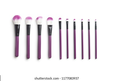 Set of makeup brushes isolated on white background.