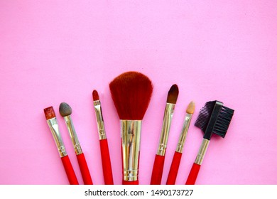 Set  of makeup brushes  on a pink background. Flat lay, top view, copy space