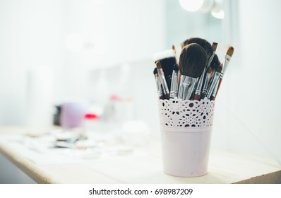Set of make-up brushes on the table