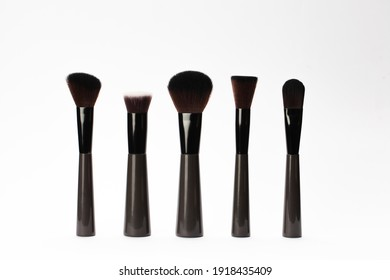 Set of makeup brushes on white background, flat lay. Space for text