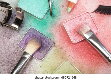 Set of make-up tools: palettes, brushes, pen, eyelashes and curler on white