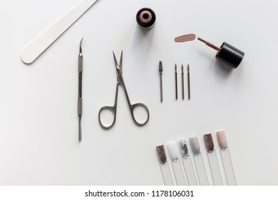 Set for manicure. Scissors, nail polish, nail file on a white background. Top view