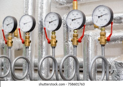 Set of manometers in industrial heating system in a boiler room.