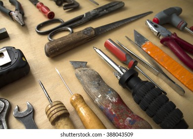 Set of manual tools on a wooden boards background/Tool renovation on grunge wood/Different tools on a wooden background.