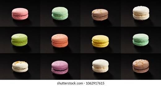 Set of many macaroni multicolored. Delicious macaroons isolated on black background. French sweet cookie