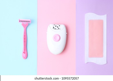 a set of means of hair removal. Wax strips, modern epilator and razor on a colored background. Minimalism, choice. top view, flatlay
