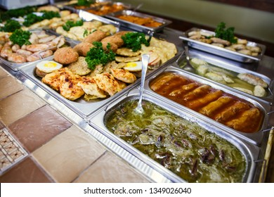 A set of meat dishes in the trays, a banquet table