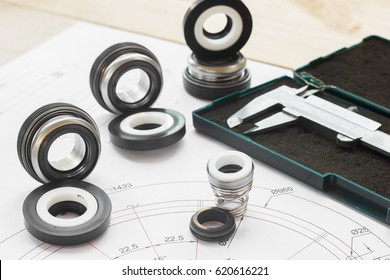 Set Mechanical Seals for prevent liquid leak for the industry with drawings on table working.