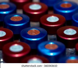 Set of medical glass vials seen from above/Medical vials