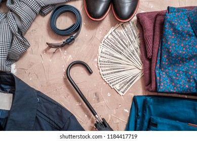 Set of men's clothing and accessories on blue wooden table. concept of businessman, classic fashion. a lot of money in your pocket.