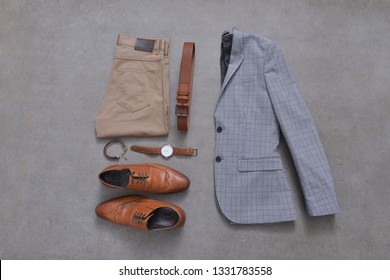 set of Men's fashionable clothes and accessories-gray background