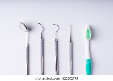 Set of metal Dentist's medical equipment tools, top view