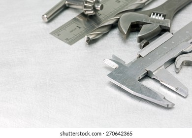 Set of  metal working tools on scratched background