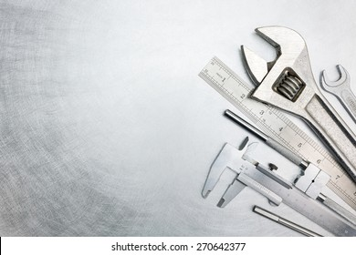 Set of  metal working tools on scratched metal surface