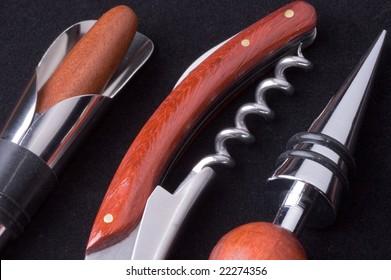 Set of metallic bar tools on a black background