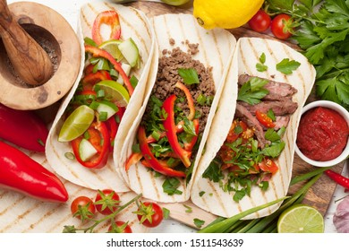 Set of mexican tacos with meat and vegetables. Cooking ingredients. Top view flat lay