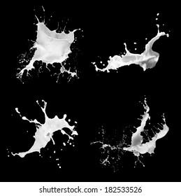 set of milk splashes on black