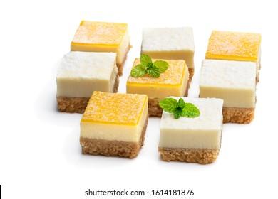 Set of  mini lemon and vanilla cheesecake bites isolated on white