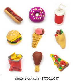 Set miniature fast food model from clay on white background. Hot dog, hamburger, ice cream, chicken, donut, soda etc.