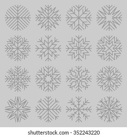 set of minimalist snowflakes on grey background