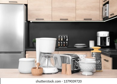 Set with modern domestic appliances in kitchen