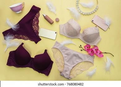 Set of modern female lingerie on yellow backgound, flat lay