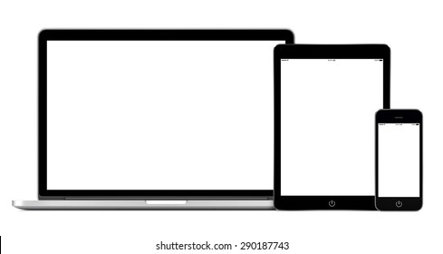 Set of modern gadgets includes laptop, digital tablet and smartphone mockup with empty white screen for responsive design presentation. All gadgets in focus. High quality. Isolated on white background