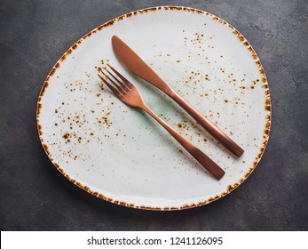 Set of modern tableware. Plates and cutlery.