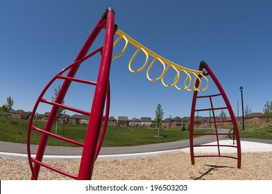 A set of monkey bars on a playground.